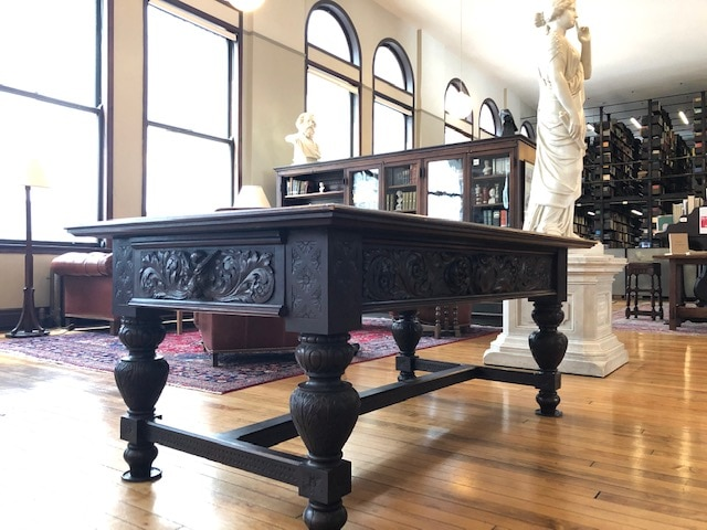 An art-carved library table